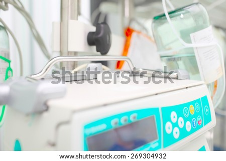 Modern device for intravenous drip - stock photo