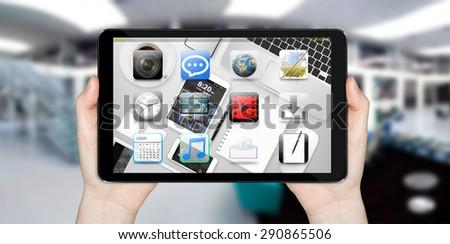 Modern digital tactile tablet on blured office background - stock photo