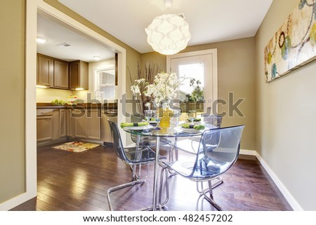 Modern dining area with glass table set. Open floor plan. Northwest, USA