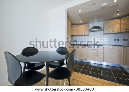 modern dining area with open plan kitchen - stock photo