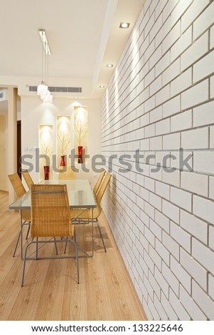 Modern Dining Room with decorative wall