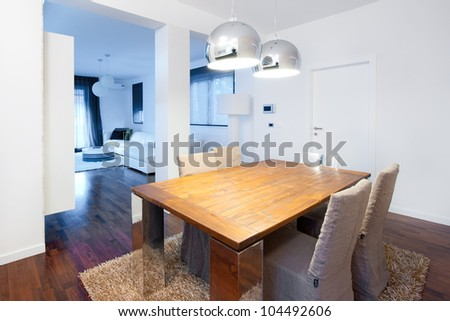 Modern dining room with designer furniture - stock photo