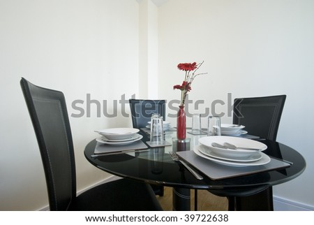 modern dining table set up with flowers