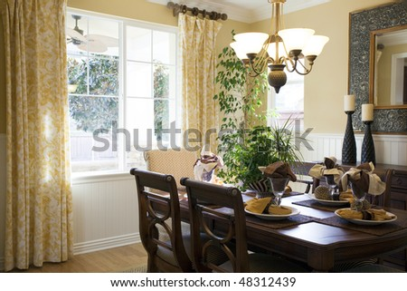 Modern dinning room with lots of natural light - stock photo