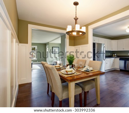 Modern dinning room with nice interior, and hardwood floor. - stock photo