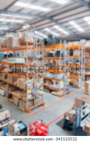 Modern distribution warehouse with blur applied to image - stock photo