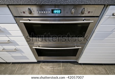 modern domestic stainless steel electric oven with digital display - stock photo