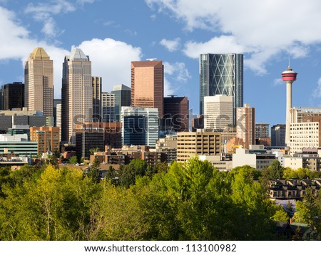 Modern downtown skyline full of skyscrapers - Calgary, Alberta Canada. Two symbols of Calgary downtown are visible - Bow Building (Encana building) and Calgary Tower. - stock photo