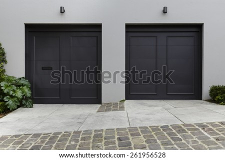 Modern Driveway Dark Garage Doors Stock Photo 261956528 Shutterstock