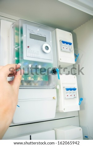 Modern electric meter close up view - stock photo