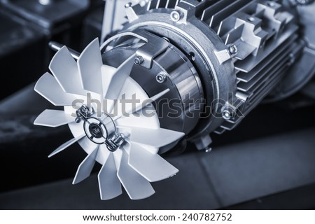 Modern electric motor fragment, blue toned photo - stock photo