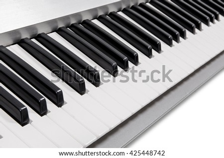 modern electric piano keys in metallic casing on white background