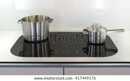 modern electronic kitchen with ceramic cooktop panel  - stock photo