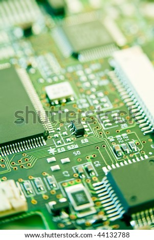 modern electronics with shallow depth of field in green - stock photo