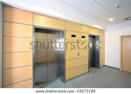 Modern elevator in office building - stock photo