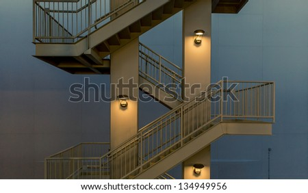 Modern emergency exit staircase at dusk - stock photo