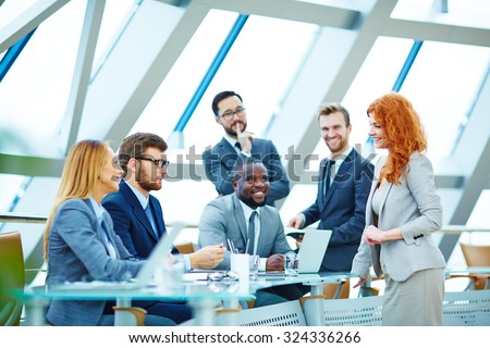 Modern employees communicating at meeting - stock photo