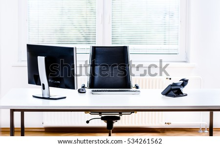modern empty office space desk with computer phone and chair concept of corporate job