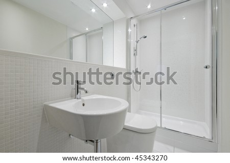 modern en-suite bathroom with white mosaic tiles