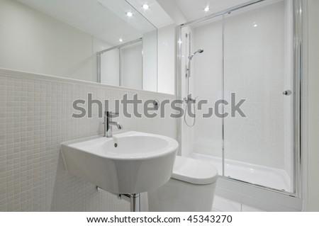 Luxury modern en suite bathroom with marble finish stock photo - Modern Blue Bathroom Shower Cabin Stock Photo 36639712