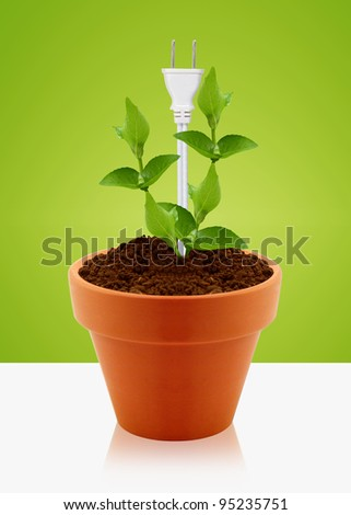 modern energy-saving concept,  bright bulb in garden pot with small plant. - stock photo