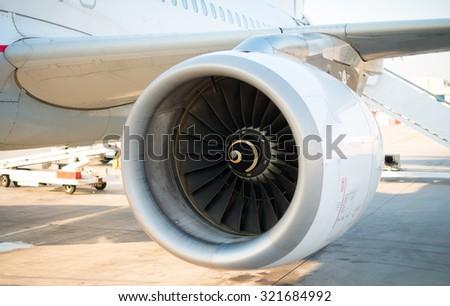 Modern engine of passenger airplane in airport. - stock photo