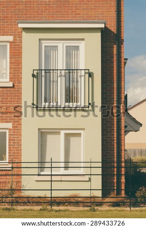 Modern English house with Juliet balcony vertical image - stock photo