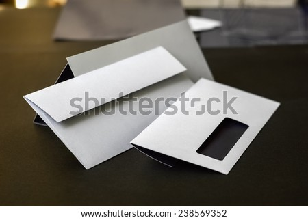 Modern envelopes with a window. Shallow depth of field. Template for design presentations. - stock photo