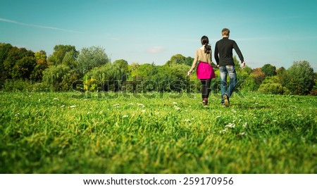 modern European couple of hipsters in love have fun outdoors - stock photo