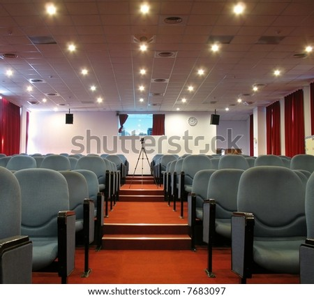 Modern Event Hall -- with elevated rows of seats and a sound room