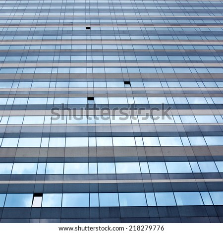 modern facade with open windows reflecting sky