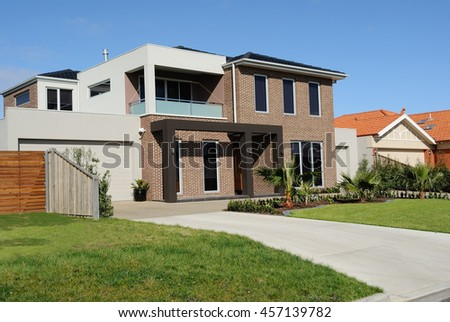 Modern family home on a new street, Melbourne, Australia - stock photo