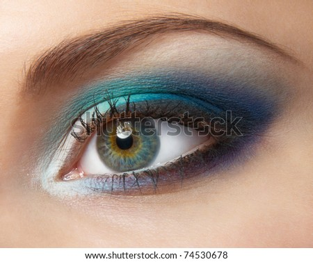Modern fashion blue makeup of a female eye - macro shot - stock photo