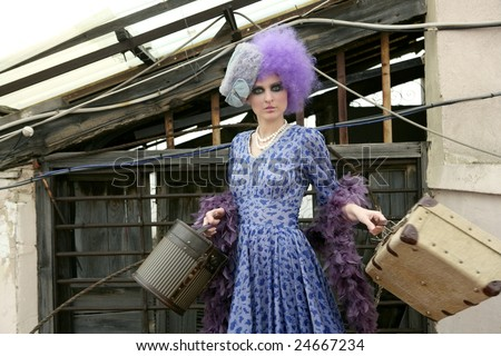 modern fashion vanguard woman leaving home with baggage - stock photo