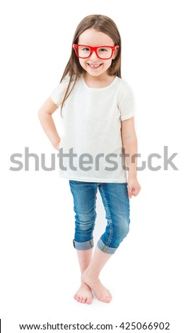 Modern fashionable little girl in full growth standing barefoot on a white background. Casual style white tshirt jeans denim red glasses. Empty space t-shirt for text logo or image. Template branding
