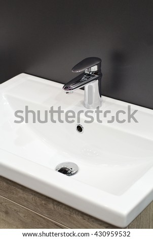 Modern faucet and sink in the bathroom