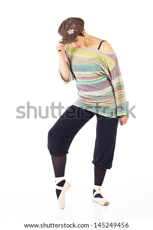 Modern female ballet dancer with black pants and a colorful striped jersey and cap en pointe on a white background in various ballet positions.