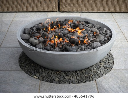 modern fire pit on backyard patio