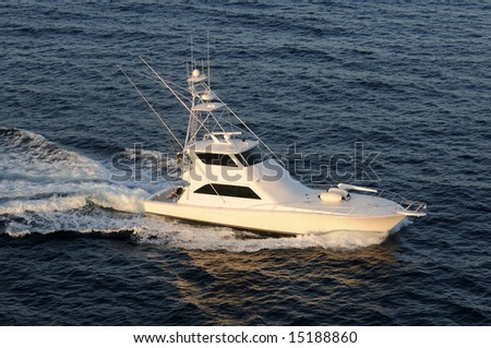 Modern fishing boat heading out to see top view - stock photo