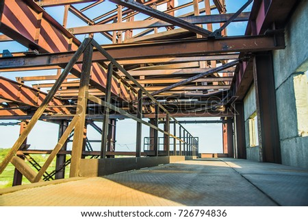 Modern Frame Work Of Metal Construction Carcass Roof Support Of Building.  Rusty Metal Beam Of