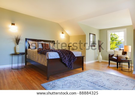 Modern fresh bedroom with oak floor and browns bed. - stock photo