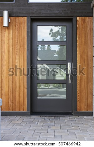 Modern front black door with frosted windows