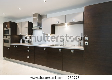 Modern fully fitted kitchen - stock photo