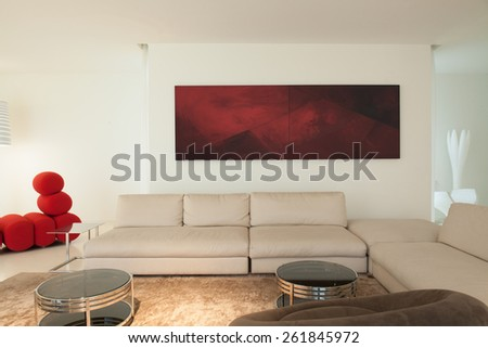 Modern furnished living room in contemporary mansion - stock photo