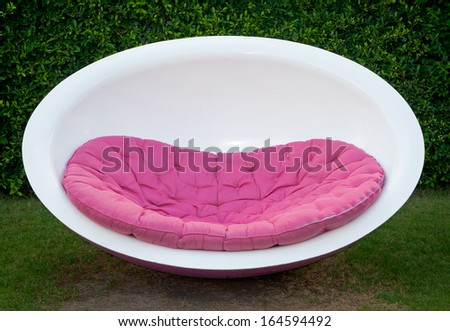 Modern furniture round chair on the lawn. - stock photo