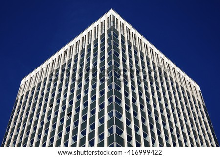 Modern futuristic tower block office skyscraper buildings architecture, with a clear blue sky in a downtown financial business district in England, UK - stock photo