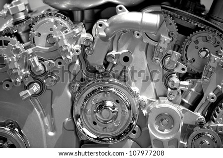 Modern Gasoline Engine Technology. Metal Shiny Car Engine Closeup Photography.