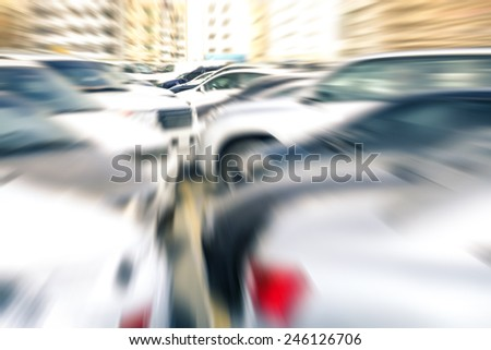 Modern generic unrecognizable cars at parking lot of company retail store - Concept of transportation and rental service with full optional insurance - Radial zoom defocusing                           - stock photo