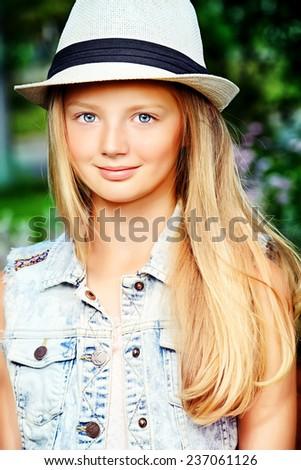 Modern girl teenager posing outdoor. - stock photo
