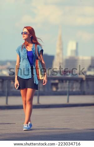 Modern girl walking on the street in Brussels - stock photo